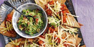 visualizes a potential presentation for CBD guacamole and nachos recipe